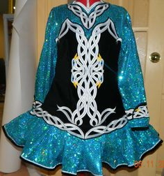 She likes the blue/ green sequin fabric color. Like the skirt style too