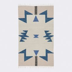 Aztec-inspired and totally cool, the blue triangles on our Janessa Kelim Rug will set a casual atmosphere for your guests.