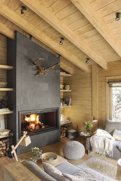 Dreamy rustic cabin in the middle of a Spanish forest. Dreamy rustic cabin in the middle of a Spanish forest. This rustic cabin in the middle of a forest in Spain took three years to renovate, maintaining the romanticism of a logger-style cabin. Cabin Fireplace, Modern Fireplace, Living Room With Fireplace, Living Room Cabin, Living Area, Cabin Interiors, Cabin Homes, Living Room Designs, House Design