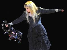 Stevie onstage ~ ☆♥❤♥☆ ~ swishing around her tambourine, that's all decorated with beautiful satin ribbons at the Bridgestone Arena, in Nashville, TN, on November 8th, 2016 while on her '24 Karat Gold' Tour, 2016