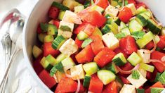 Cucumbers add a welcome crunch to this refreshing summer salad of cubed watermelon, fresh herbs, and crumbled feta cheese. You can replace the fresh