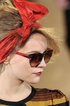 Oversized hair accessories this summer.  Glasses too.