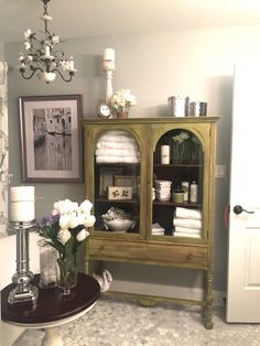 Refurbished antique curio cabinet for added storage/display.
