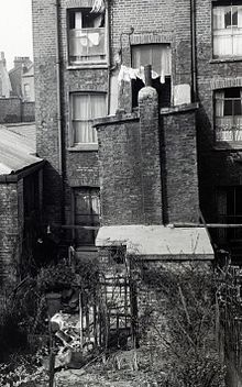 John Christie was a notorious English serial killer active in the 1940s and early 1950s. He murdered at least eight females – including his wife Ethel – by strangling them in his flat at 10 Rillington Place, Notting Hill, London. Christie moved out of Rillington Place in March 1953, and shortly afterwards the bodies of three of his victims were discovered hidden in an alcove in his kitchen. His wife's body was found beneath the floorboards of the front room.