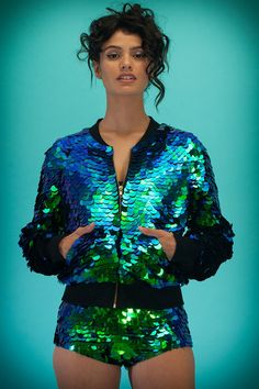 Hand-stitched iridescent sequins on a high-quality cotton jersey fleece base Metal zipper, and pockets Sizes M/L and XL/XXL are designed to be...