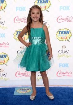 Mackenzie Ziegler chose a green dress with sequin accents along the waist for the Teen Choice Awards. Description from stylebistro.com. I searched for this on bing.com/images