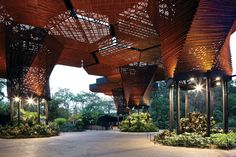 """""""Orchideorama"""": These giant wood and steel """"trees"""" provide shelter for an orchid garden below. Designed in a honeycomb fashion, each module can be altered as the plant life needs change; Botanical Garden, Medellín, Colombia 