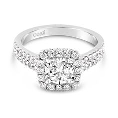 Ecali Presents: A delicate claw set halo and double row diamond band combine to highlight the beauty of a cushion cut diamond in this gorgeous white gold engagement ring.