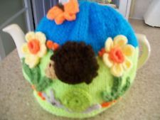 Hand knitted Spring hedgehog snail  tea cosy for a medium teapot