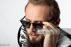 Stock Photo : Man looking over sunglasses