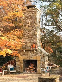 This enormous outdoor fireplace is the focal point of this mountain home's backyard. Don't forget to outfit an outdoor fireplace                             as you would an indoor one. A shelf mantel and decorative vases make the space feel like a living room. Gorgeous!