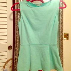 Mint Green Peplum Top Just in time for spring! Pair with skinnies and heels or your favorite pencil skirt. New without tags! Forever 21 Tops Tank Tops