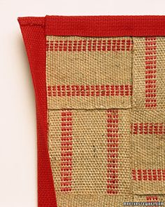Inventive use of humble materials is a hallmark of good interior design. Rough jute upholstery webbing is normally hidden beneath layers of batting and fabric. When handwoven in a simple under-and-over pattern, this practical textile becomes a trim, durable floor mat or decorative runner for a front hallway.
