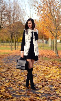 so nice... the lbd with sheer tights and suede boots and a white faux fur vest