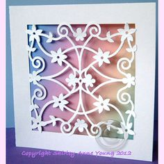 Here is a card made using the same design as the freebie Flower Panel Topper. You can either just use the template as it is or layer it up ...