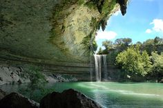 Hamilton Pool near Austin, Texas - There is a 45 foot water fall creating a great swimming hole. This wooded canyon has delighted many who have swum in the bright green lagoon