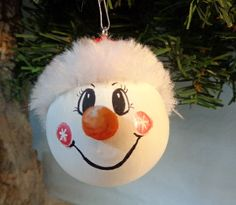 Hand painted gourd snowman ornament.  He is about 2 inches in diameter and is painted with acrylic paint.  He and his friends are available in our Etsy shop, We Are Out of Our Gourds.   #paintedgourdornament#snowmanornament