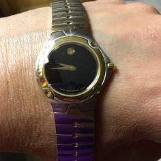 "Movado Movado SE watch. Scratches on the bracelet, crystal face not scratched.  No extra links. Will fit a 6 1/2""-7"" wrist. Classic watch. Stainless with gold dots on each link. Battery works. No case/papers Movado Accessories Watches"