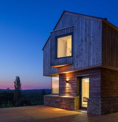A new build house in the Cotswolds designed by Millar + Howard Workshop Architects.  Burnt larch cladding and Cotswold Stone.
