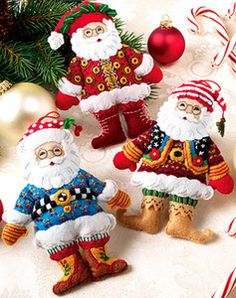 Felt Santa Ornaments. I thought they looked like ME Santas, and they are! They are also out of stock every site I checked.