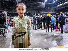 Sheffield, UK - June 12, 2016:  Young girl dressed as the character 'Rey' from 'Star Wars' at the Yorkshire Cosplay Convention at Sheffield Arena
