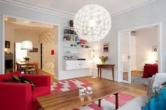 Here we have a lovely home design that works perfectly also for smaller apartments, because of the touches of energy and color. The example for this type of decorating is