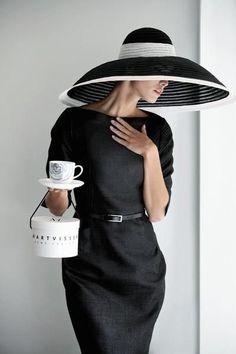 Beautiful down turned brim black and white hat.