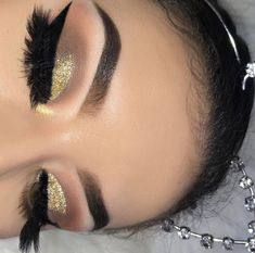 Glitter gold eyeshadow with bold winged liner, perfect brows and false lashes #makeup #cateye #glittereyeshadows #perfectwingedliner #goldeyeshadows