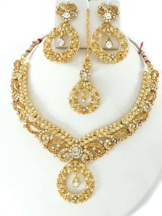 party wear jewellery designs; costume necklace set online shopping; Gold color costume jewellery set at our online wholesale store.