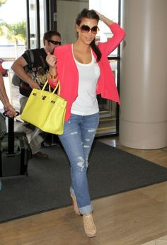 pink sweater, tattered jeans, white shirt & yellow bag