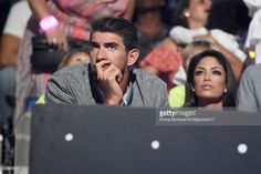 Honoree Michael Phelps (L) and model-Miss California USA 2010 Nicole Johnson during Nickelodeon Kids' Choice Sports Awards 2017 at Pauley Pavilion on July 13, 2017 in Los Angeles, California.