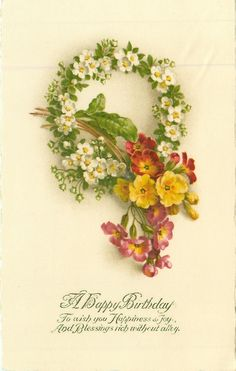 Wreath of white blossoms, with primrose.  Birthday message.