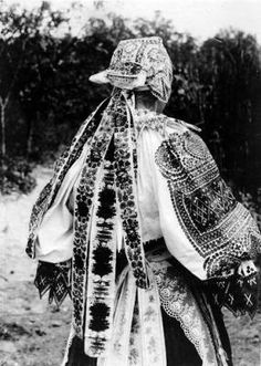 Woman in costume from behind, Slovakia (Slovak Republic), (former Czechoslovakia), circa 1930-1937 :: Blanche Payne Regional Costume Photograph and Drawing Collection