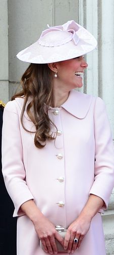 Who made Kate Middleton's pink coat, clutch handbag, and hat? Hat – Jane Corbett  Purse and coat – Alexander McQueen