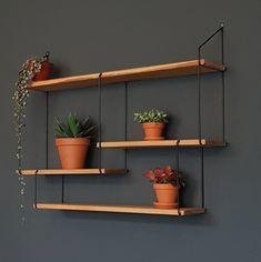 Tastefully combining sleek, German design and the beauty of authentic Bosnian woodwork, Studio Hausen offers beautiful interior decoration for the modern home. Wood Shelves, Floating Shelves, Shelving, Living Pequeños, Living Room Sofa, String Shelf, Warm Home Decor, Interior Decorating, Interior Design