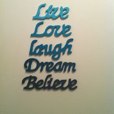 Wooden words painted ombré and hung on wall with removable sticky pads