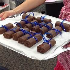 Swiss rolls and your schools colors ribbons to look like miniature diplomas! Another cheap yummy snack for grad party!