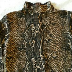 """Animal  print turtleneck  body suit Animal print with some sparkle/shimmer to the material. Back zip. Very minimal wear,looks new. No tags. Armpit  to Armpit  17"""", Sleeve 24"""", Length 29"""" unknown  Tops"""