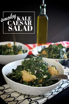 SMOKY KALE CAESAR SALAD makes 3-4 servings  1 tablespoon red wine vinegar 1 tablespoon lemon juice 2 cloves garlic, sliced 2-3 anchovy filets, chopped 1  1/2 teaspoons dried chili powder 1  1/2 teaspoons smoked paprika salt & pepper 1/4 cup extra-virgin olive oil 1/2 cup Parmesan cheese, grated 1/3 cup sharp white cheddar, shredded 1 egg yolk 9-10 cups lacinato kale, chopped (about 2 bunches) 2 cups red pepper/paleo croutons/ toasted nuts-shredded coconut