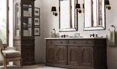 love the mirrors in this bathroom with the sconces on either side