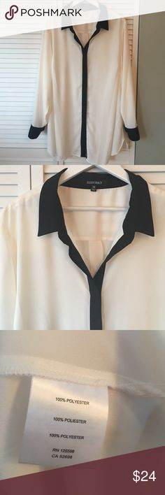 """Classic cream and black blouse 🌟 This is a brand new without tags Ellen Tracy ivory and black classy button down blouse.  The black trimmed sleeves, front and neck make this top very classic!  An elegant oeuvre to have for the office wardrobe or for your holiday outfit!  Polyester material , button front and sleeve .  The sleeves measure 25.5"""" and the length measures 31"""".  A beautiful must have!  🌟🌟 Ellen Tracy Tops Blouses"""