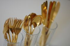 I love this - vintage gold cutlery for hosting dinner parties - gorgeous.