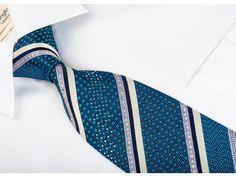 https://www.san-dee.com/rhinestone-ties/brand/perry-ellis/perry-ellis-rhinestone-silk-tie-turquoise-striped-on-navy-with-silver-sparkles.html