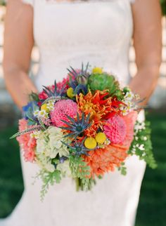 april flowers work. multi colored bright bouquet. nice with soft greens to accent bmaids.