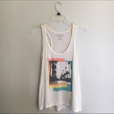 ‼️American Eagle tank top‼️ Cute tank top! A few minor stains... Not noticeable when worn! American Eagle Outfitters Tops Tank Tops