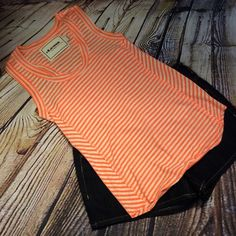 CLAESON NEON STRIPED TANK Love this tank of a rayon/polyester blend in neon or and and white with a racer back Claeson Tops Tank Tops