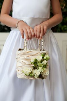 For a modern alternative to sprinkling rose petals at the ceremony, give your flower girl a pretty, flower-adorned handbag to hold!