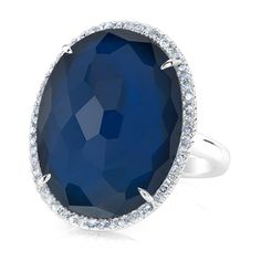 """14KT White Gold Dark Azul Diamond Oval Doublet Cocktail Ring<br /> Ring measures approximately 1"""" x 1/2""""<br /> Doublet is a new way to showcase precious stones by layering them. This combination is Dark Azul and White Topaz to add depth to the ring."""