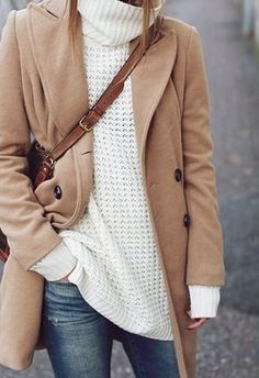 Camel coat, chunky ivory knit turtleneck, faded denim, chestnut cross body bag.