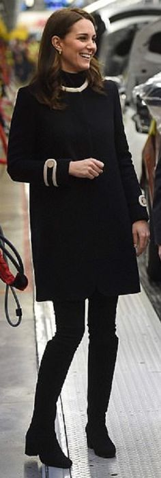 Kate wore a coat (Washington style) designed by Goat and boots by Russell and Bromley